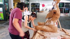 Artist woman working with her student at the 12th International Eskisehir Terra Cotta Symposium. Eskisehir, Turkey - September 04, 2018: Female artist working at stock video footage