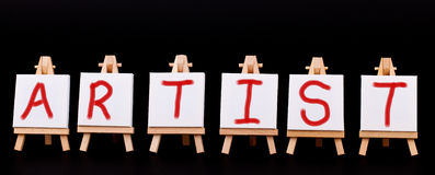 Artist word spelled across six easels. On a black background royalty free stock images