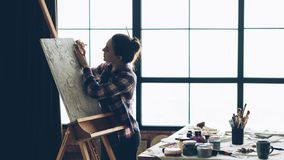 Artist work artwork canvas easel woman tool. Artist at work. Artwork in process. Canvas on easel. Woman painter with tool. Studio workspace. Copy space royalty free stock photo