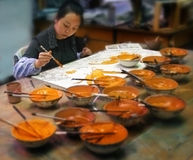 Artist at work in her studio - Beijing - China Stock Photography