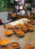 Artist at work in her studio - Beijing - China Stock Image