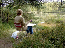 Artist at work on the moor. The moor, heath on a sunny autumn day, an artist, painter painting royalty free stock photos