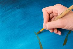 Artist paints with oil paints. The artist at work paints with oil paints stock images