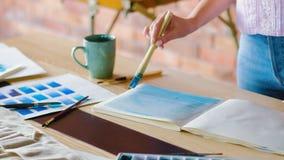 Artist work start painting album abstract blue stock footage
