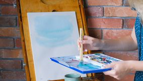 Artist work start painting easel abstract blue stock footage