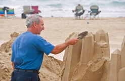 Artist working on beach Stock Photography