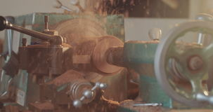 Artist working on a lathe processing wood stock video footage