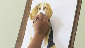 Artist working on a painting royalty free stock photography