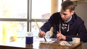 Artist working on painting stock footage