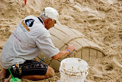 Artist working in sand Royalty Free Stock Photo