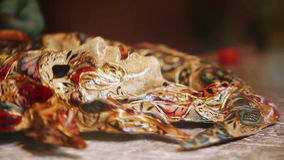 An artist works on a festive and ornate Venetian carnival mask.  stock video footage