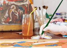 Artist works on new icon with brush Stock Image