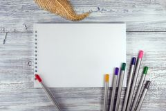 Artist workspace. Drawing tools, stationary supplies, workplace of artist. blank paper on white wooden desk, top view, flat lay, c royalty free stock images