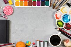 Artist workspace on gray stone background. Top view. Mock up Stock Photography