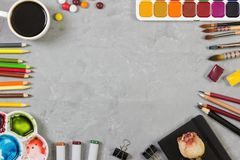 Artist workspace on gray stone background. Top view. Mock up Stock Image