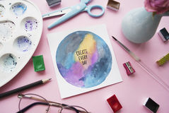 Artist workspace. Inspirational quote `create everyday`. Flat lay Stock Image