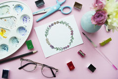 Artist workspace on a pink background. Flat lay Royalty Free Stock Photo