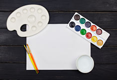 Artist workspace with watercolor palette Royalty Free Stock Photography