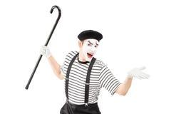 Artista del mimo che tiene una canna e gesturing Fotografia Stock