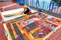 Artista della via che attinge la pittura della via del pavimento Immagine Stock Libera da Diritti