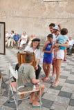 Artista e turisti italiani della via Immagine Stock