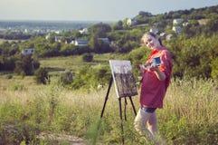 Artista en el aire llano fotografía de archivo