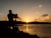 Artista no por do sol imagens de stock
