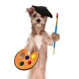 Artista With Paint Brush del perro y paleta Fotos de archivo