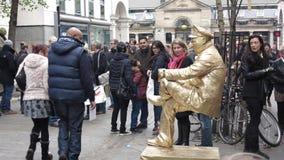Artista vivente della via della statua Immagine Stock