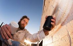 Artista Working della pittura della parete fotografia stock