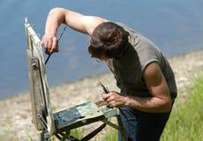 Artiste peignant l'étude Images libres de droits