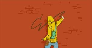 Artiste Person In Hoodie Painting On de rue de bande dessinée un mur de briques photo libre de droits