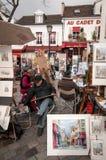 Artistes et peintures dans Mont-Martre Photographie stock libre de droits