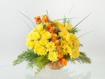 Artistic Arrangement with Mixed Flowers. In a basket Royalty Free Stock Photos