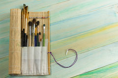 Artistic, artist, art. Used artist paintbrushes mastehin on wood background Royalty Free Stock Photography