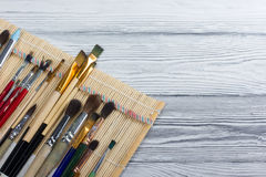 Artistic, artist, art. Used artist paintbrushes mastehin on wood background Stock Photo