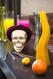 Artistic atmosphere: vase with colored water, creative mood, skull in beret Stock Image