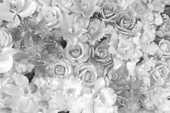 Artistic Background of Plastic Flowers in black and white. stock photos
