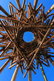 Artistic bamboo circular sculpture against blue sky. Nestlike sculpture created from bamboo wood against blue sky Royalty Free Stock Images