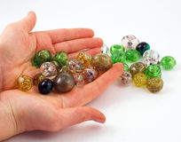 The artistic beads in the hands Royalty Free Stock Photo