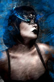 Artistic beautiful woman with short hair and Venetian mask, gas Stock Photos