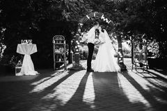 Artistic black and white photography. Wedding photography. Black and white art photography monochrome, groom and bride in a white dress on a background of a Royalty Free Stock Photo