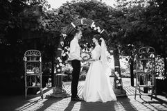 Artistic black and white photography. Wedding photography. Black and white art photography monochrome, groom and bride in a white dress on a background of a Royalty Free Stock Images