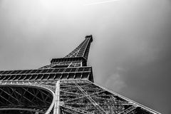 Artistic black and white wide angle shot of the eiffel tower. The french Eiffel tower in paris, seen from below, showing the arc, bottom and top in a Stock Photos