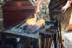Artistic blacksmith works in the historic blacksmith workshop Royalty Free Stock Photography