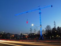Artistic blue construction crane Stock Photos