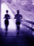 Artistic blur of a running couple royalty free stock photo