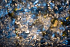 Artistic bokeh. Blurred beautiful dark background of crumpled foil. stock images