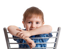 Artistic boy sits on chair Stock Image
