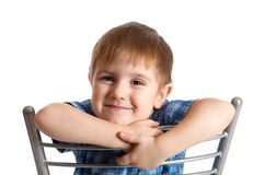 Artistic boy sits on chair. Royalty Free Stock Photo